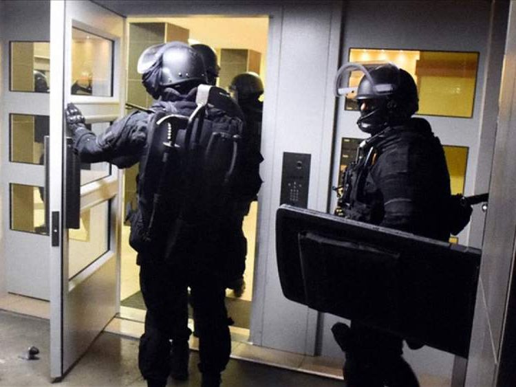 Police prepare to raid an address in Toulouse