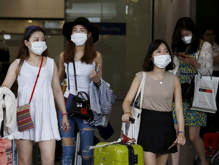 Mers disease outbreak hits south korea economy south korean visitors arriving from seoul wearing masks arrive at hong kong airport in hong kong publicscrutiny Gallery