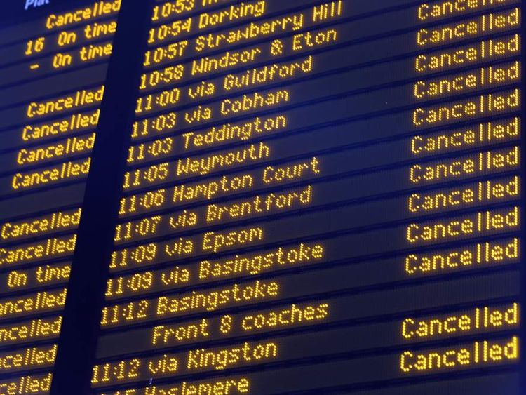 A departure board in Waterloo Station displays numerous cancellations to rail services which have been caused by severe weather