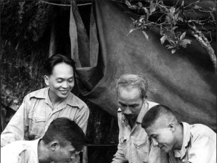 Picture dated 1950 of General Vo Nguyen Giap (l background) with Vietnamese President Ho Chi Minh (2nd r)