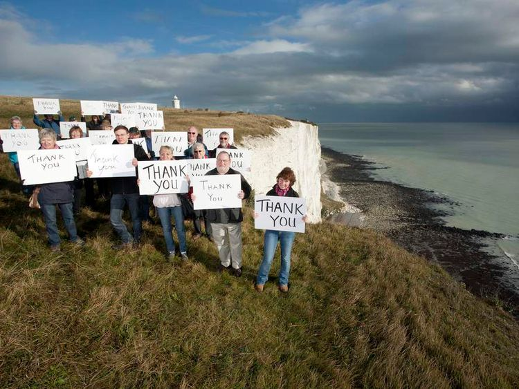 "National Trust holding up placards to say ""thank you"" to the fund raisers"