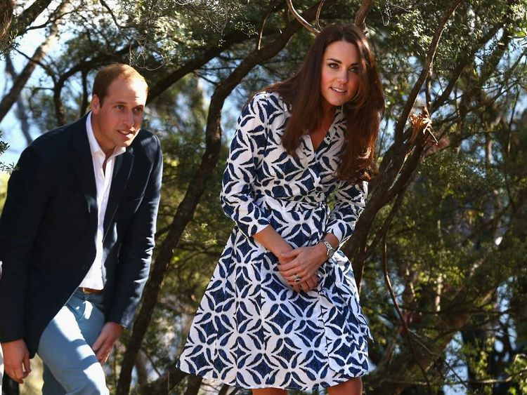 Prince William, Duke of Cambridge, and Catherine, Duchess of Cambridge, walk through the bush as they observe abseiling and team building exercises