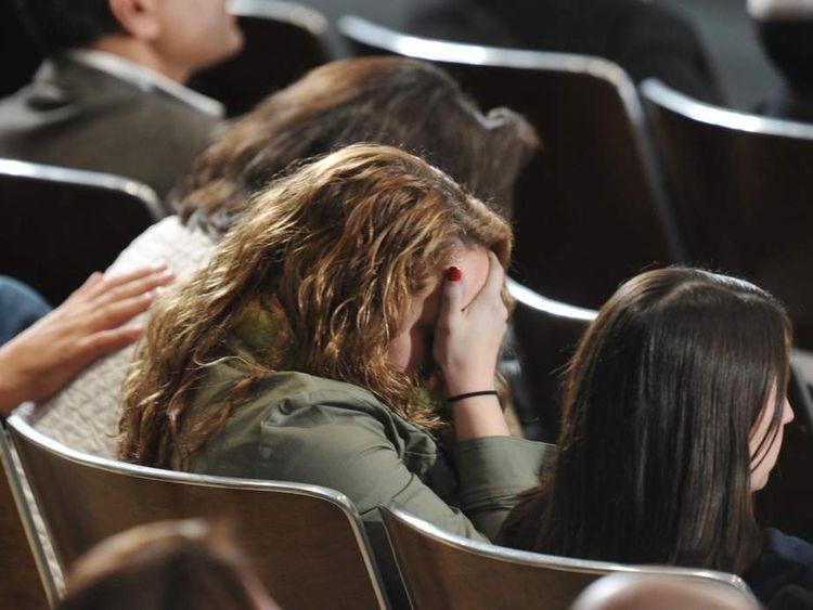 Woman grieving at Newtown vigil