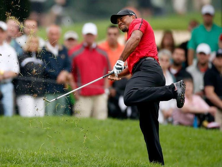 Tiger Woods plays second shot on second hole during final round at Firestone