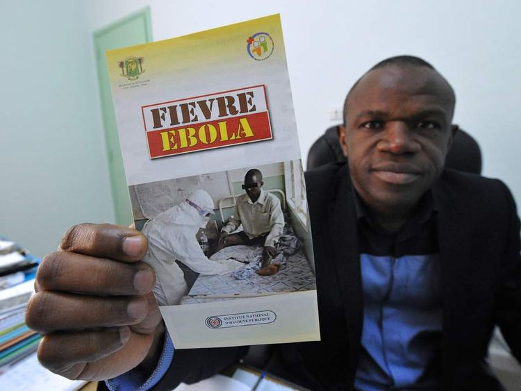 A health expert displays a a warning leaflet