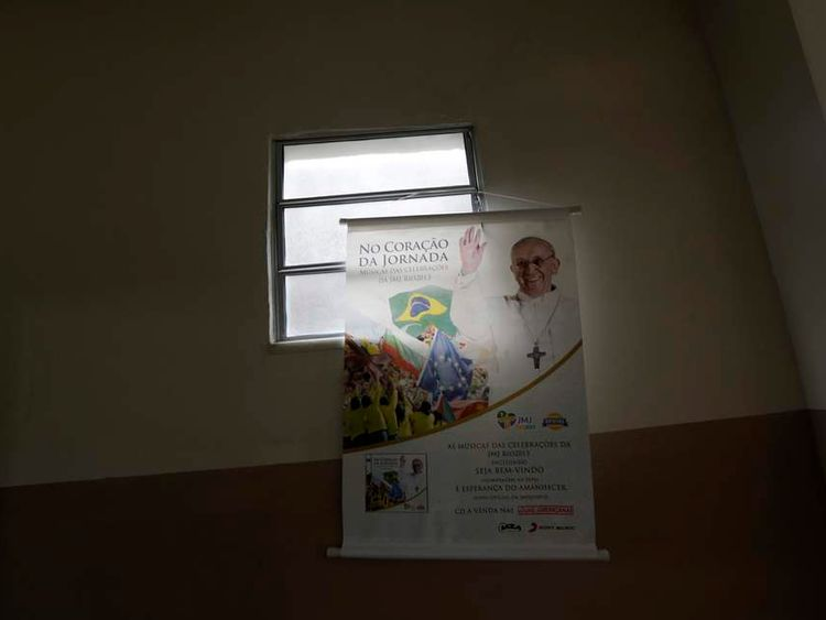 A banner promoting World Youth Day is seen inside the Chapel of Sao Jeronimo, where Pope Francis is expected to visit during his upcoming trip to Varginha slum in Manguinhos slums complex in Rio de Janeiro