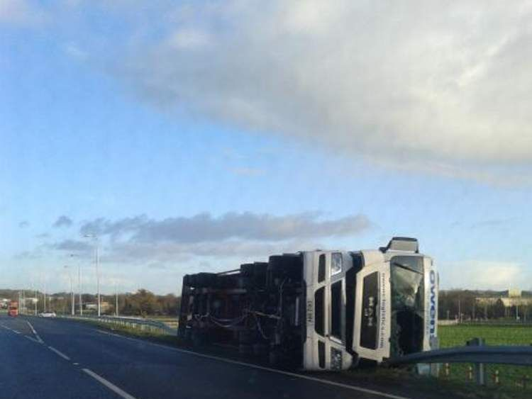 An overturned lorry in Wrexham