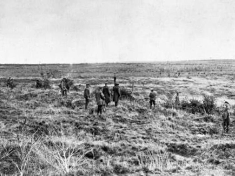 Soldiers search for bodies on the Western Front in 1919 after WW1