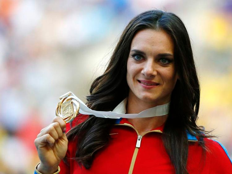 Gold medallist Isinbayeva of Russia holds her medal at the women's pole vault victory ceremony during the IAAF World Athletics Championships in Moscow