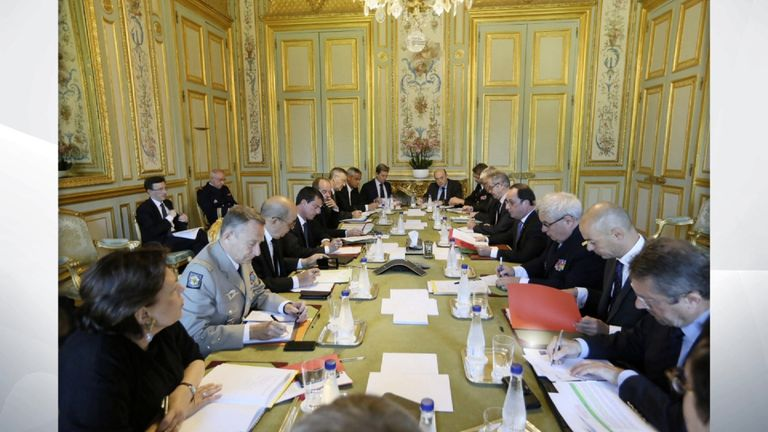French President Francois Hollande leads an emergency meeting in Paris