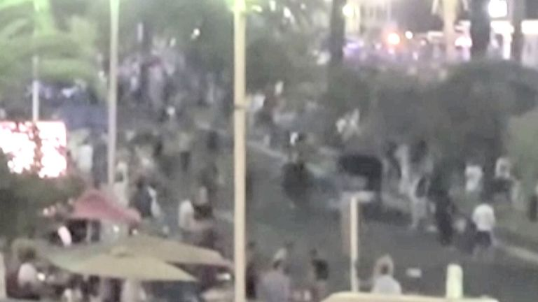 Video of the lorry before it drives into the crowd in Nice, France. It shows police attempting to stop the driver before he drives off down the promenade.