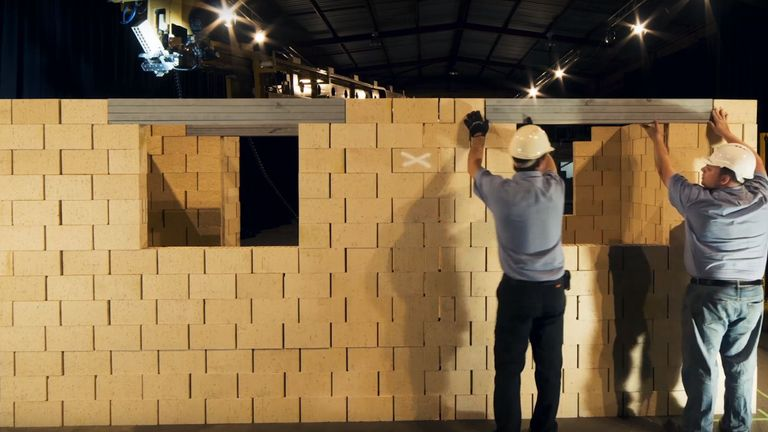 Human workers can put the finishing touches to the building