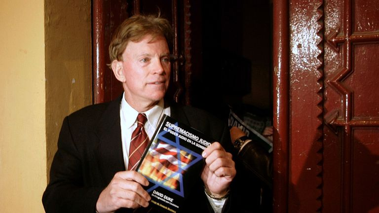 David Duke, former Grand Wizard of the Knights of the Ku Klux Klan, speaks to journalists on a street in Barcelona, Spain, in November 2007
