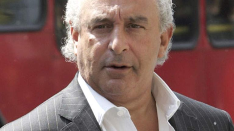 Sir Philip Green stands outside Top Shop on Oxford Street