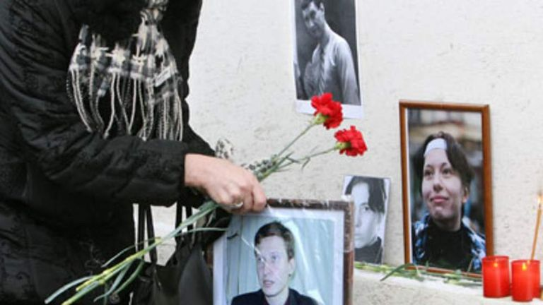 Flowers placed at the spot where Stanislav Markelov and Anastasiya Baburova were gunned down