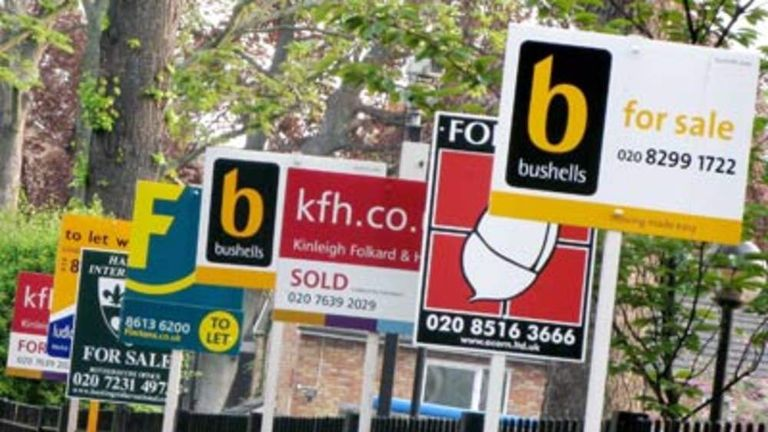 Estate agents boards on a street in London