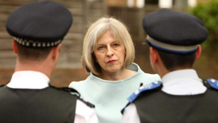 Home Secretary Theresa May talks to police officers