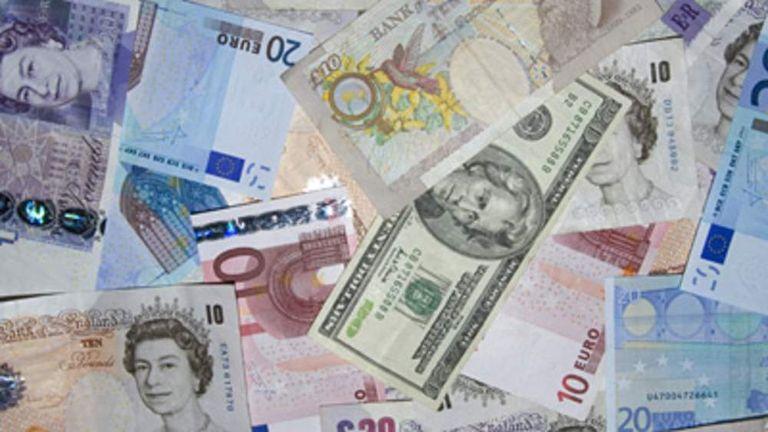 pound notes, euros and dollar bills