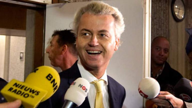 Dutch politician Geert Wilders leaves court after being cleared of all charges relating to inciting hatred and discrimination against Muslims