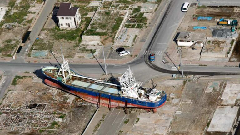 An aerial view shows Kyotoku-maru fishing trawler which swept by ashore by the March 11 earthquake and tsunami in Kesennuma, Miyagi prefecture, Japan