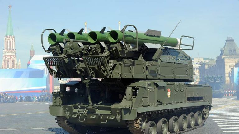 A column of Russia's air defence system Buk-2M  launch vehicles rolls at the Red Square in Moscow, on May 9, 2013, during Victory Day parade.