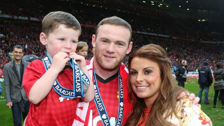 Wayne Rooney, with wife Coleen and son Kai