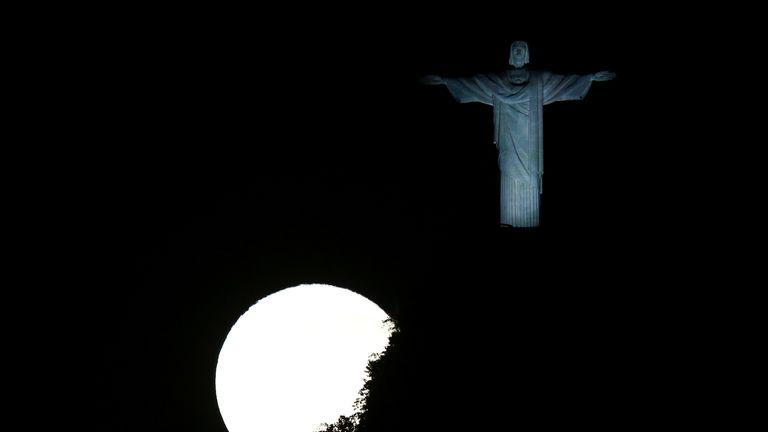 A full moon illuminates the Christ the Redeemer statue in Rio de Janeiro, Brazil