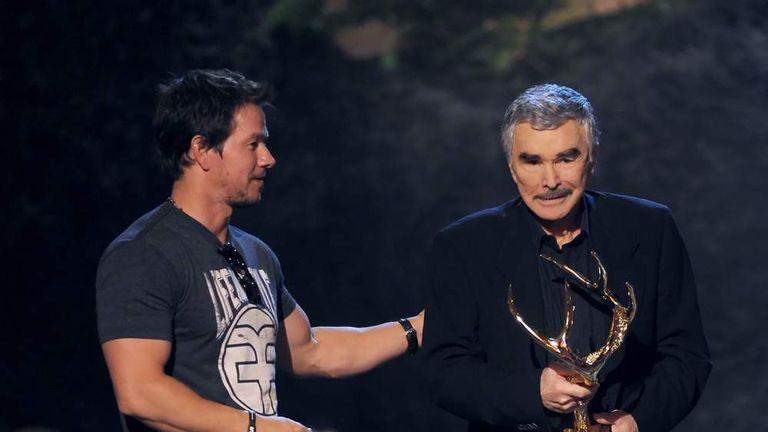 Mark Wahlberg presents award to actor Burt Reynolds