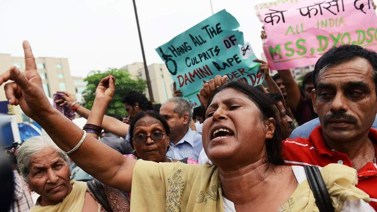 Protesters outside a court in Delhi when four men were sentenced for rape and murder
