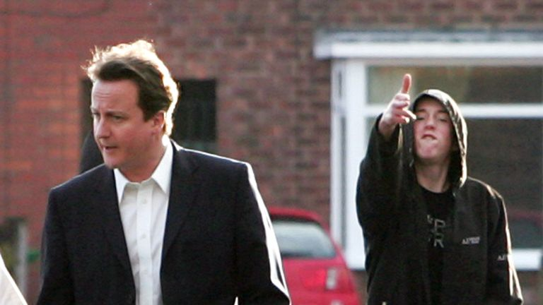 David Cameron and a boy pretending he has a gun