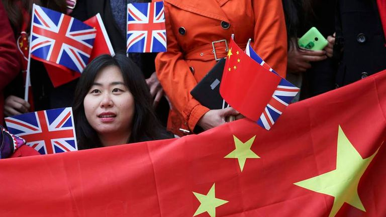 Supporters of China's President Xi Jinping wait on the Mall for him to pass during his ceremonial welcome, in London, Britain