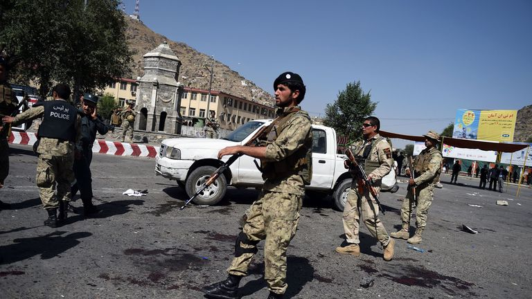 Afghan security personnel arrive after a suicide attack that targeted the minority Shiite Hazaras