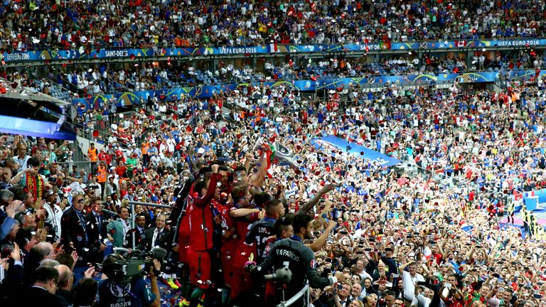 Portugal's team celebrate in front of a crowd of thousands at the Euro 2016 tournament