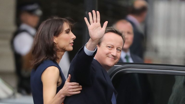 David Cameron waves goodbye as he leaves Downing Street with his family