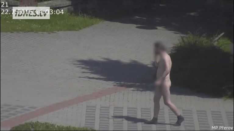 The man kept his socks on as he walked through  the streets