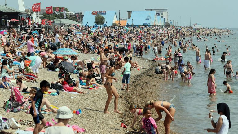 People at Southend-on-Sea enjoy the hot weather