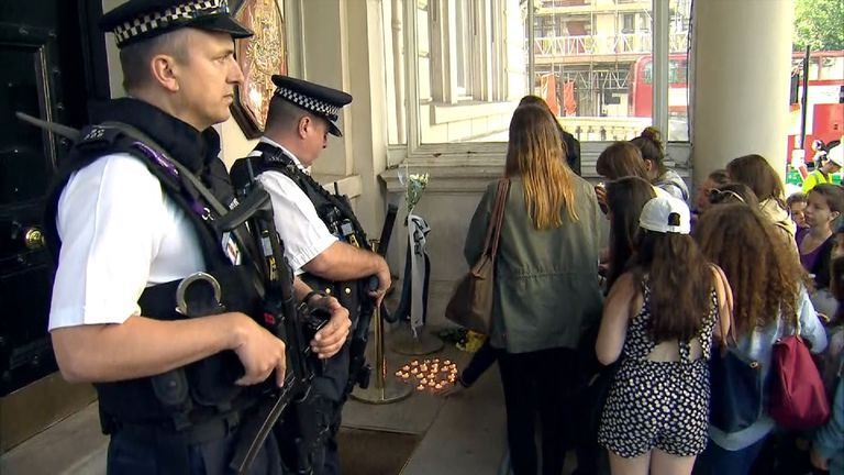 Candles lit outside the French embassy in London