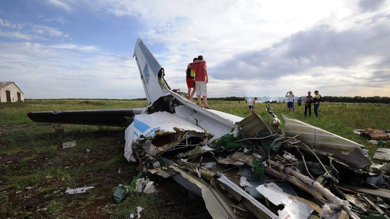 A picture taken on July 14, 2014 shows the wreckage of a Ukrainian AN-26 military transport plane after it was shot down by a missile in the village of Davydo-Mykilske.