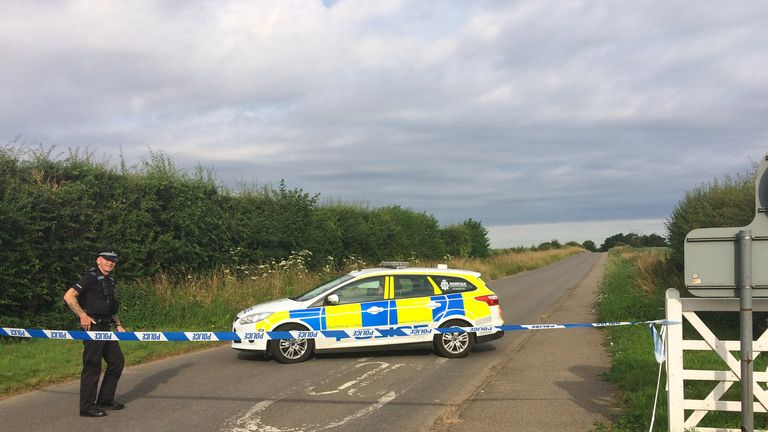 Police on Ladywood Road near RAF Marham, after a serviceman was attacked
