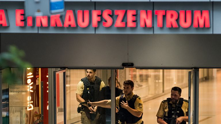 Police officers respond to a shooting at the Olympia Einkaufzentrum shopping centre