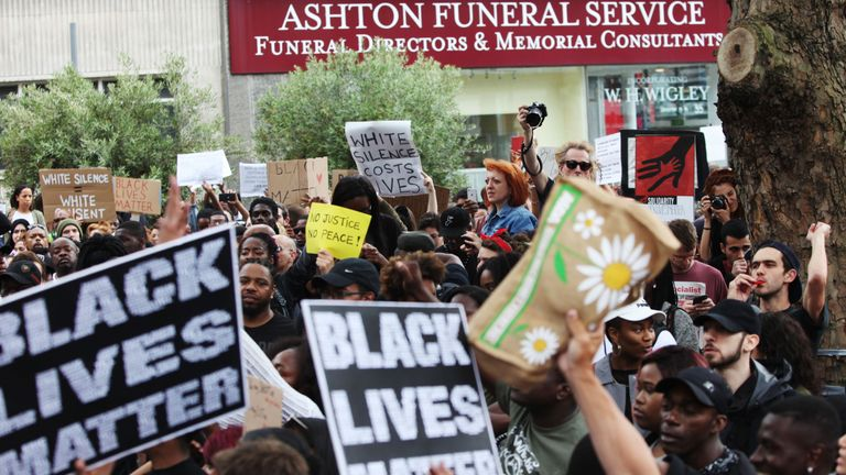 Hundreds of demonstrators protest in Brixton, London, against the killing of two black men in the US
