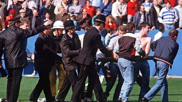 Policemen rescue soccer fans at Hillsborough stadium
