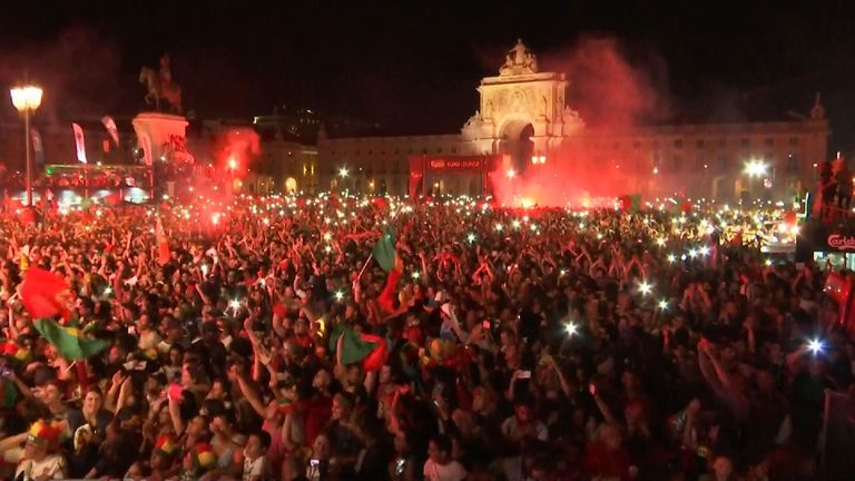 Portuguese fans celebrate winning the European football championships after beating hosts France 1-0 in the Paris final.