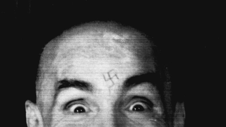 Charles Manson photographed in 1989 as he is led to his cell after an interview with Reuters