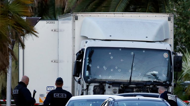 French CRS and judicial police work near the heavy truck that ran into a crowd at France's Bastille celebrations.