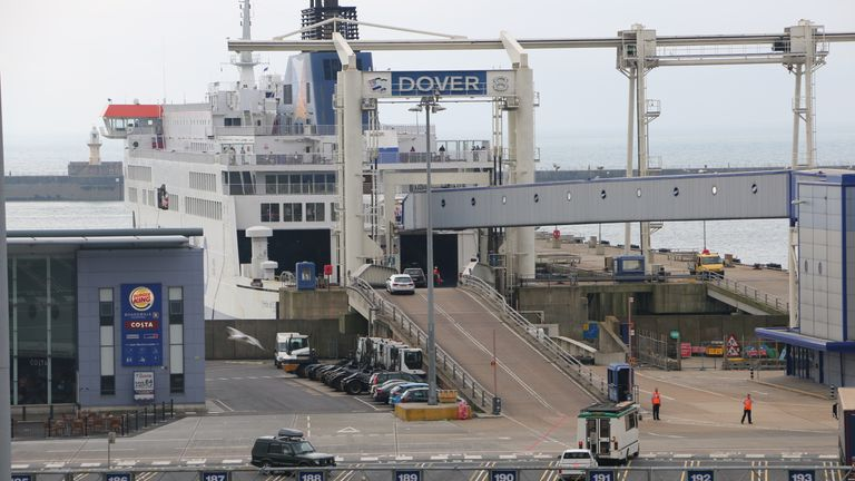 Cars board a ferry at Dover after some people queued for 15 hours to get through customs