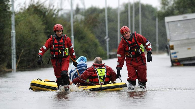Firefighters rescue stranded motorists from a flooded road outside Castleford, West Yorkshire
