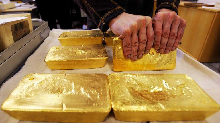 An Austrian worker handles ten kilogram 'raw' gold bars
