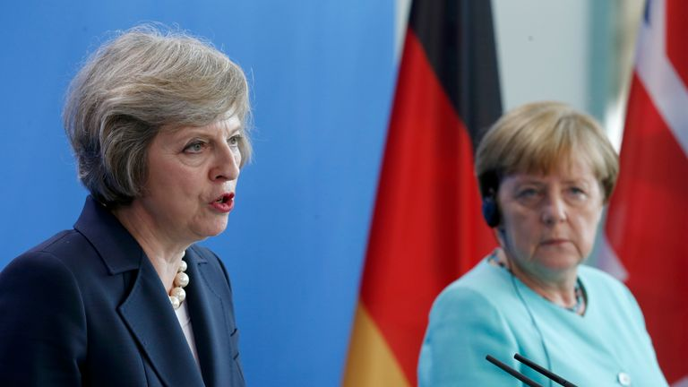 Theresa May and Angela Merkel holding a joint news conference in Berlin