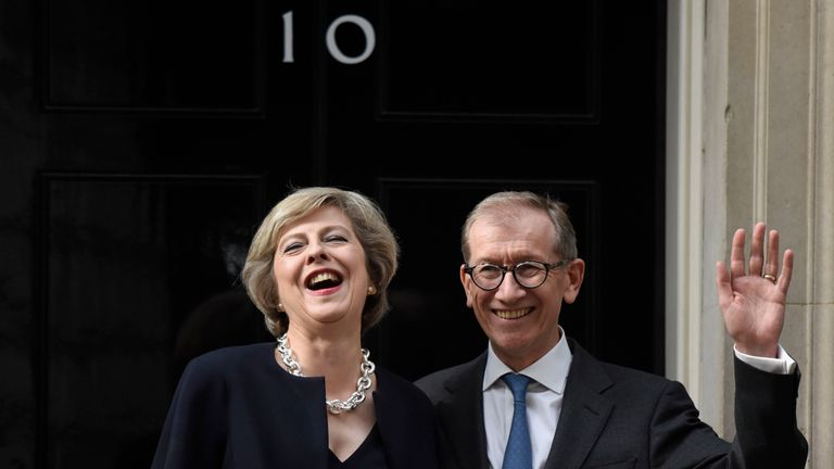 Prime Minister Theresa May and husband Philip May wave outside 10 Downing Street